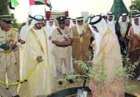 Sheikh Mohammed al-Maktoum planting the first tree of his ambitious environmental initiative