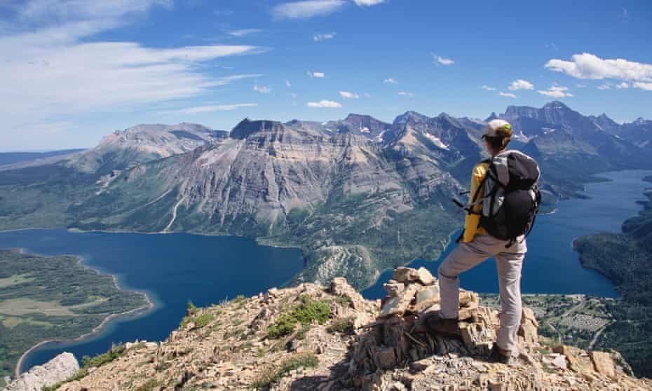 Woman Hiking, View from Randall Mountain, Waterton Lakes National Park, Alberta, Canada.