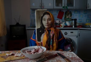 When past and present blend by Oded Wagenstein, finalistAfter photographing Vaynoto Vera in her kitchen, I asked if she could bring an object from her past as a nomadic herder in the Siberian tundra. Along with a few other items, she brought an old photograph. It was a portrait of her, taken when she was a young girl. I took another picture of her, holding this photograph.It was only when I returned home and looked at the two images, that I realized that although decades had passed, they were almost identical: the composition, the gaze, the angle, and even the floral scarf. It did not require any sophisticated editing. I just placed one image on top of the other, and suddenly, the past and present blended.