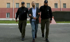Jack Shepherd escorted by police in Tbilisi, Georgia, to be extradited to Britain, where he had been on the run.