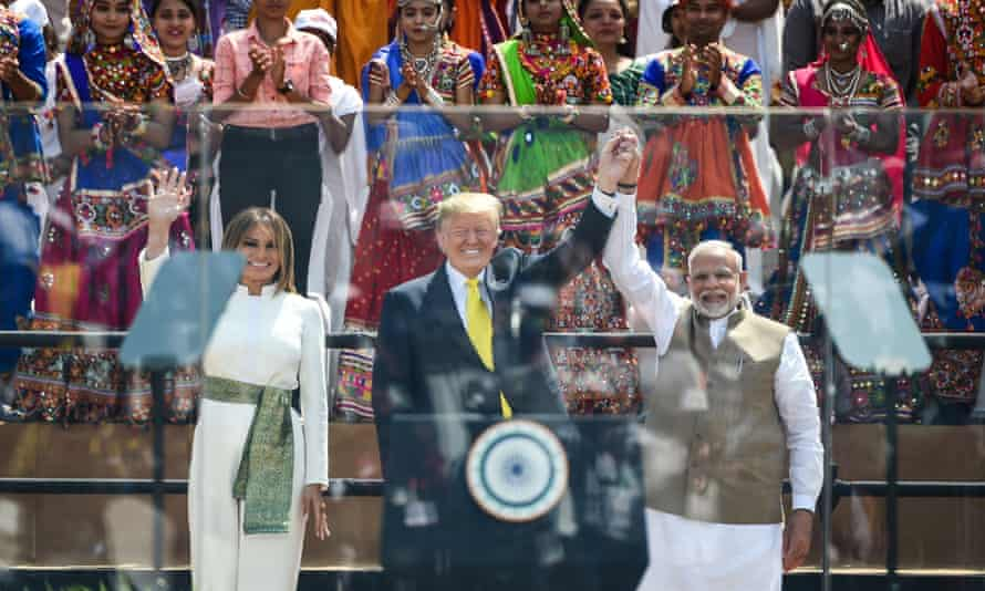 The Trumps and Modi on stage