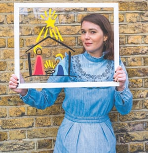 Gwen Smith holding a frame depicting nativity play