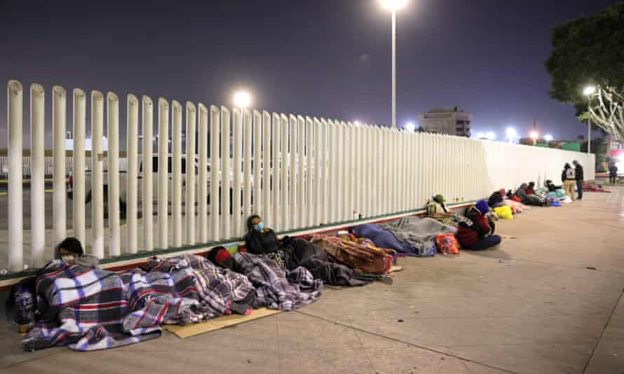 Asylum seekers try to sleep and rest at the border in Tijuana.