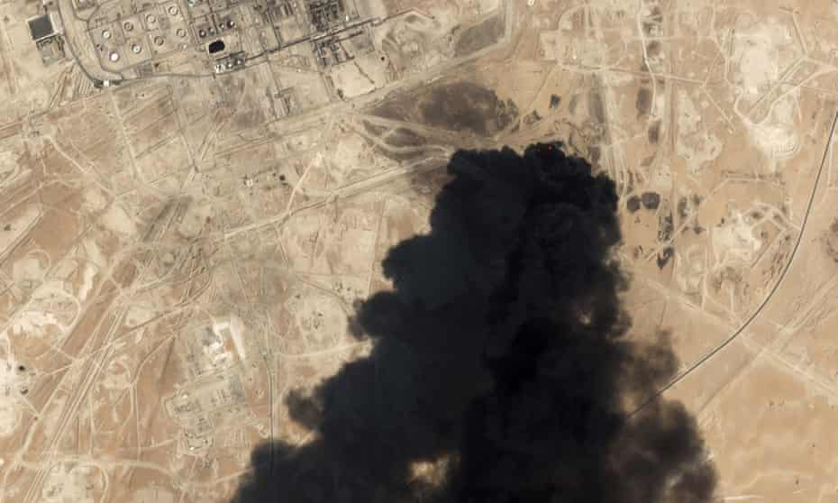 Smoke rises from Saudi Aramco's Abqaiq oil processing facility on 14 September.