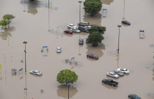In this aerial photo a parking lot of Walmart is submerged after the San Marcos River flooded in San Marcos on Sunday