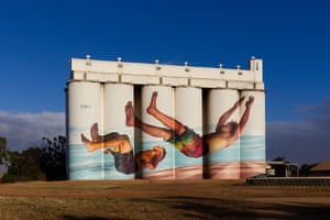 In this summery scene by Martin Ron and his assistant Matt Gorrick, two boys jump off the Tumby Bay jetty. The artists spent some time in the coastal town on South Australia's Eyre Peninsula and saw locals diving off the jetty into the sea, providing the inspiration.