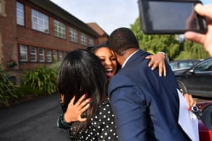 Birmingham, England Aaliyah Wallace celebrates with her family at the King Edward VI High School for Girls after getting three A*s in her A-Levels. She will study modern languages at Oxford University