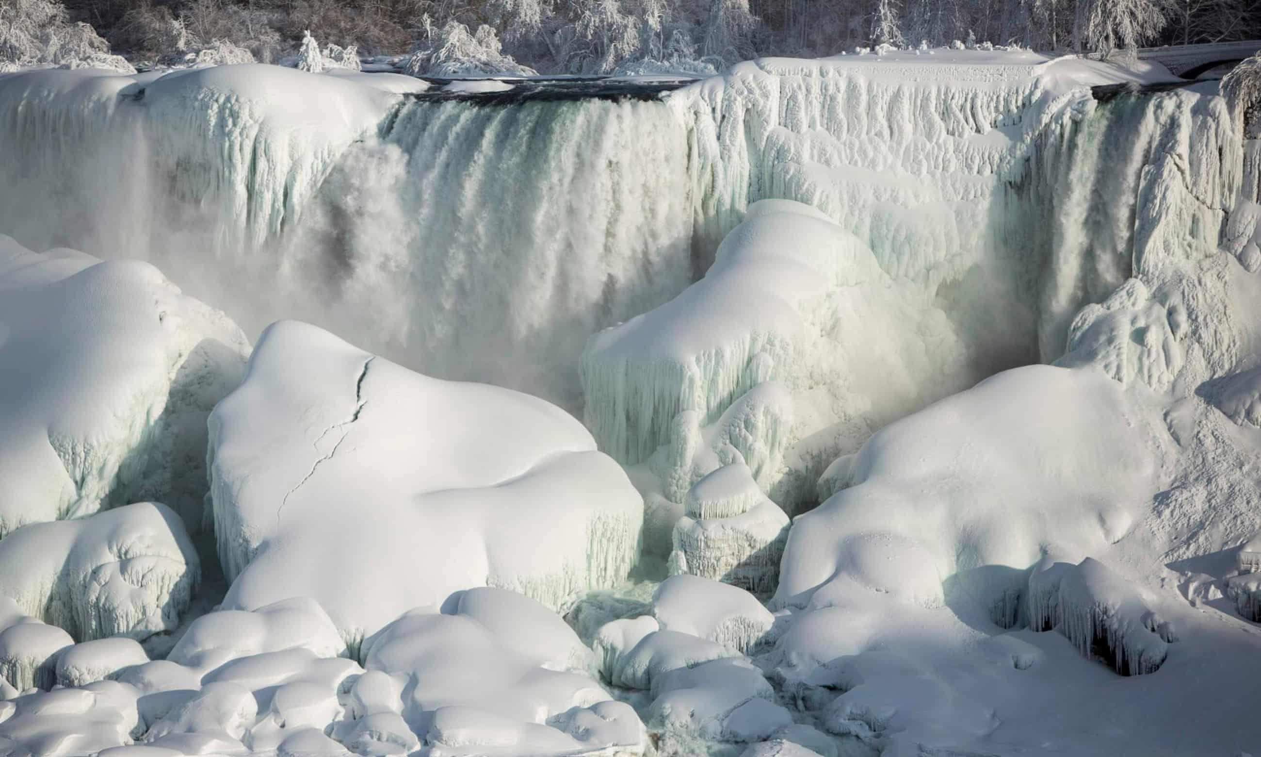 Niagara Falls freezes over as polar vortex drops temperatures – pictures