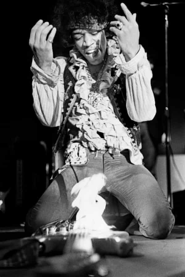 Jimi Hendrix sets fire to his Fender Stratocaster guitar while performing at the Monterey International Pop music festival, June 1967.