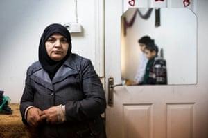 Nahla (49) and her children Isra (11) and Nuri (9) in Selimiye neighbourhood of Gaziantep