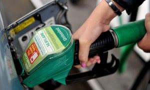 Person using a petrol pump at Asda