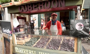 Truly scrumptious: a cuberdon sweet seller.