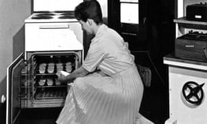 A 1960s promotional photograph of a woman using a Belling oven.