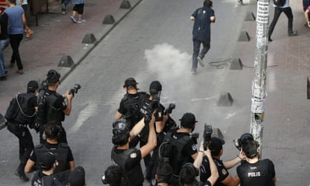 Turkish police officers fire teargas and rubber bullets to disperse demonstrators who gathered for a gay pride rally in Istanbul.