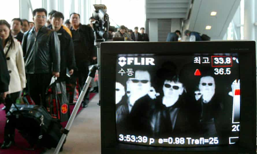 A thermal camera monitors the body temperature of passengers arriving in Seoul from Taipei to check for Sars