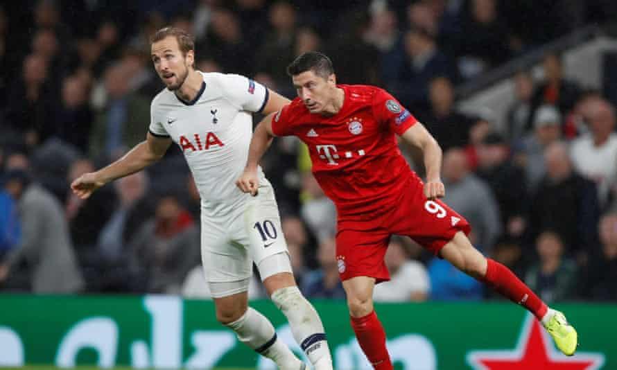 Harry Kane and Robert Lewandowski tussle during a match between Tottenham and Bayern Munich