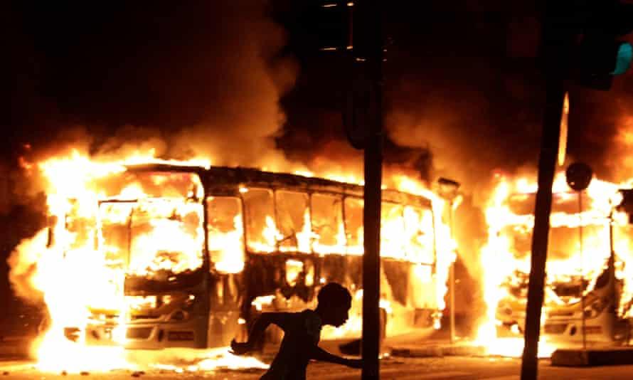 Buses burn during clashes in Rio de Janeiro.