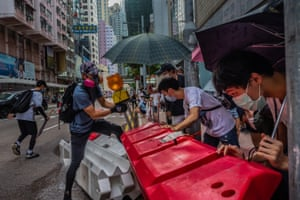 Pro-democracy protesters set up barricades