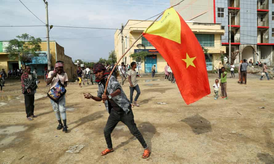 A man waves a Tigray flag in the village of Nebelet in the north of the rebel region.