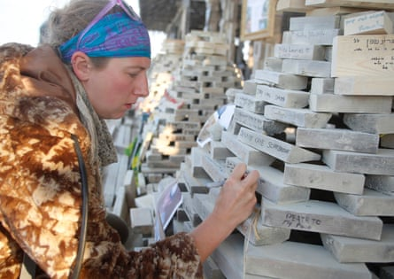 Elena Meseck writes the name of a loved one at the temple.