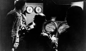 Scientists man the control panel on board the aircraft carrier Campania during atomic bomb testing in the Monte Bello Islands, Australia.