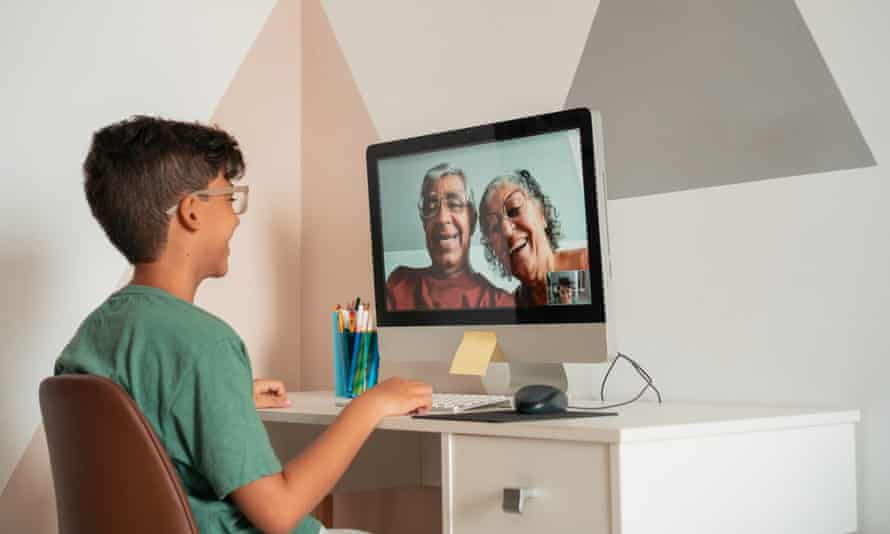 A boy talking to his grandparents by video chat.
