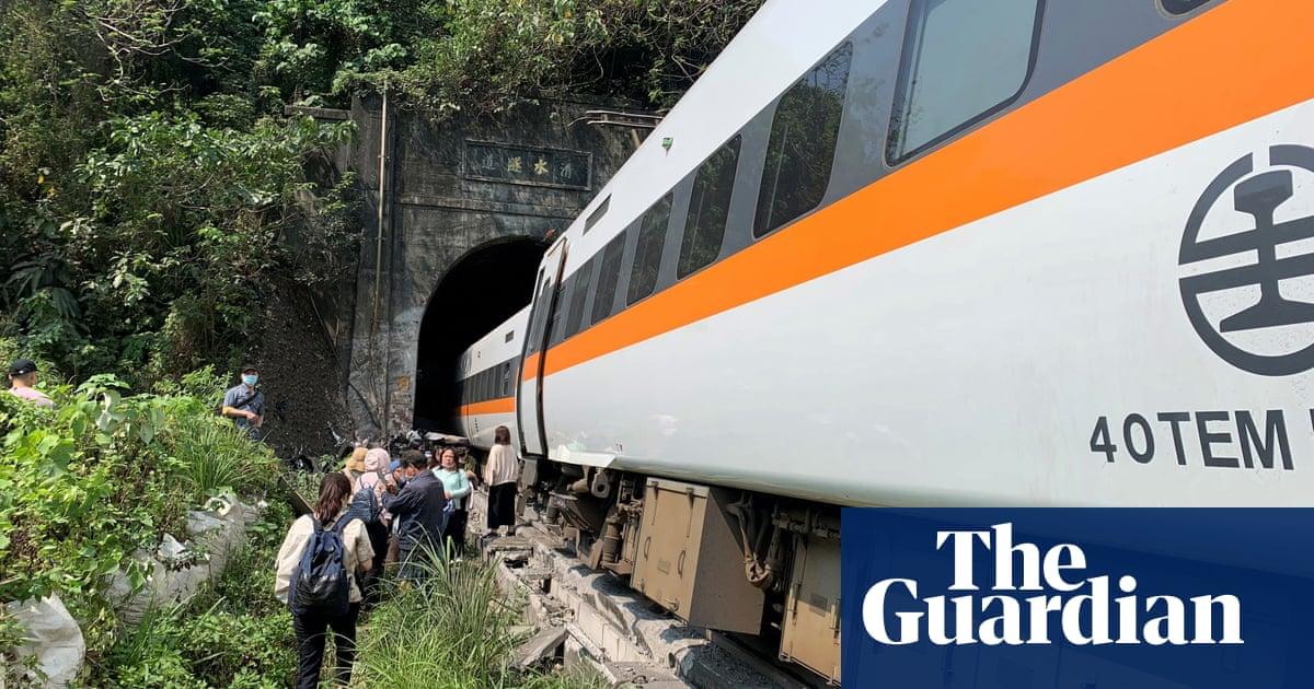 Taiwan train crash: dozens feared dead after express service derails in tunnel