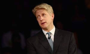 Jo Johnson speaks onstage at a rally.