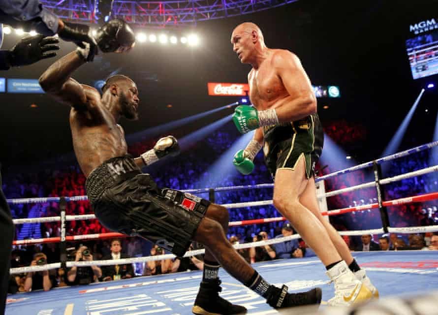 Tyson Fury knocks down Deontay Wilder during their WBC Heavyweight Title fight in Las Vegas on 22 February.