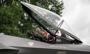 Pence examines the cockpit of the model Lockheed Martin Corp F-35 fighter jet