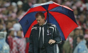 Steve McClaren, complete with brolly, watches his England side lose 3-2 against Croatia at Wembley in November 2007