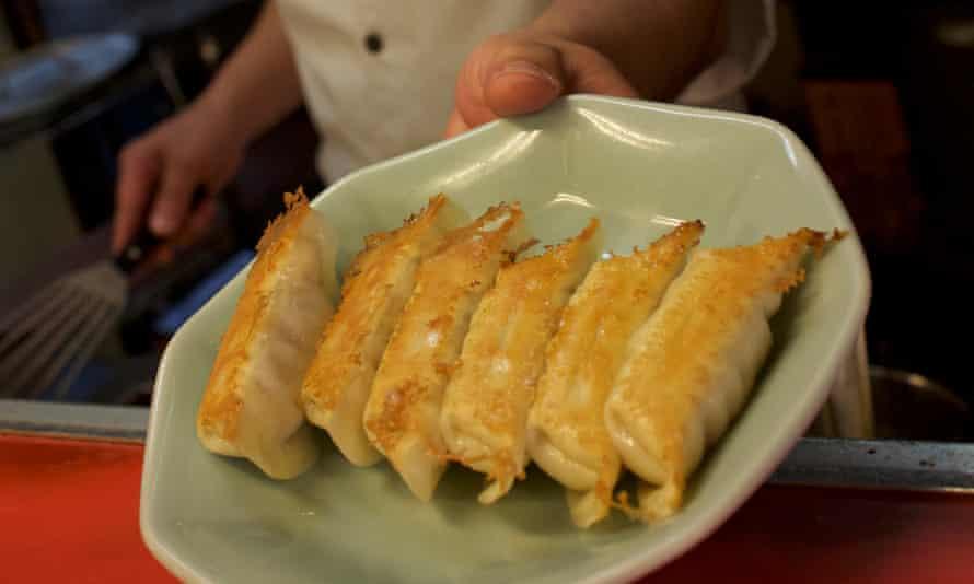 Keiichi Kawabe serves a plate of pan-fried gyoza at Minmin