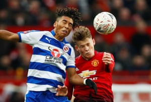 Reading's Danny Loader and Manchester United's Scott McTominay go up for a header.