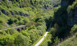 Cyclist on the Monsal trail at Chee Dale, Derbyshire, EnglandA popular cycling and walking trail on a disused railway line in spectacular limestone scenery in the Peak District national park.