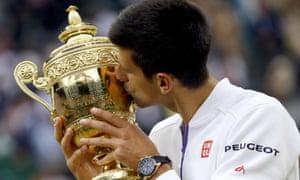Wimbledon: Novak Djokovic celebrates winning the title after beating Roger Federer.