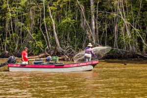 A husband/wife team cast netting for shrimp in the Port Honduras Marine Reserve, southern Belize.