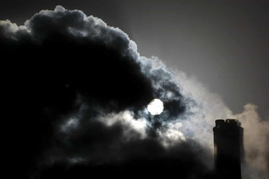 The sun seen through the steam and other emissions coming from funnels of the brown coal Loy Yang Power Station in the Latrobe Valley near Melbourne.