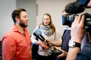 Yonathan and Lotte speak to journalists prior to a court decision last month.