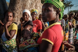 Women queue to receive relief supplies