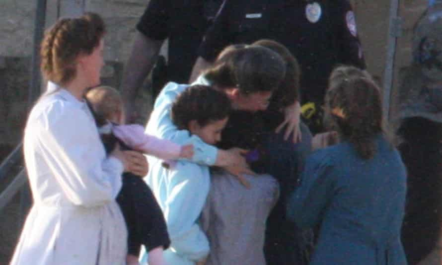Women and children of the Fundamentalist Church of Jesus Christ of Latter Day Saints who were removed from a compound in El Dorado, Texas embrace in a 2008 photo.