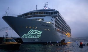 Ocean Rebellion protesters project slogans on to the World cruise ship in Falmouth harbour, Cornwall.