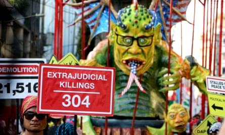 Activists gather around an effigy of Philippine President Benigno Aquino III on Human Rights Day 2015.