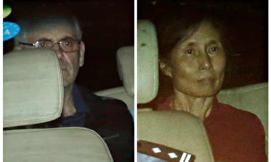 Peter Humphrey (L) and his wife Yu Yingzeng as they leave court in August 2014.