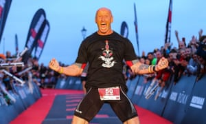 Celebrating after completing his first Ironman.