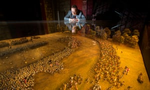 Curator Malcolm Mercer and the exhibition's miniature model of the Battle of Agincourt.