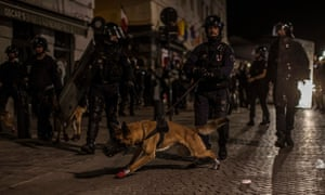 French riot police patrol the streets of Marseille on Saturday night.