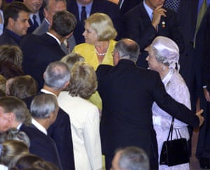 John Howard clears the way for the Queen during a Parliament House reception in 2000. He later denied touching her.