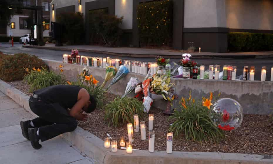 A man pays his respects at a memorial in Los Angeles.