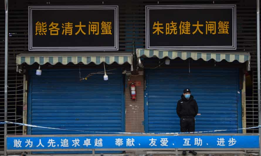 Security guard outside shuttered seafood market