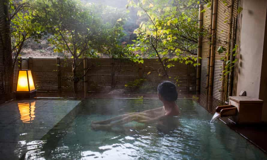 Bathing in Kawayu Onsen.